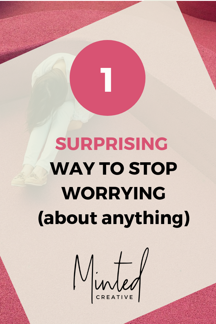woman sitting with head on knees in a corner with text overlay - 1 surprising way to stop worrying (about anything)