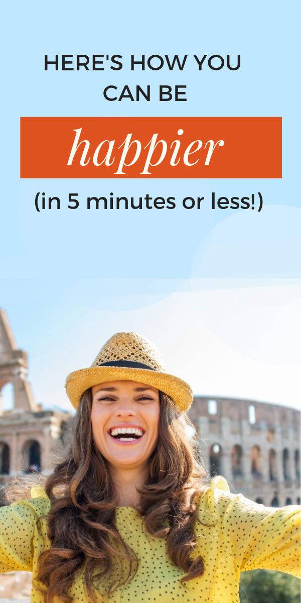 how-to-be-happier- brunette woman with straw hat smiling at camera