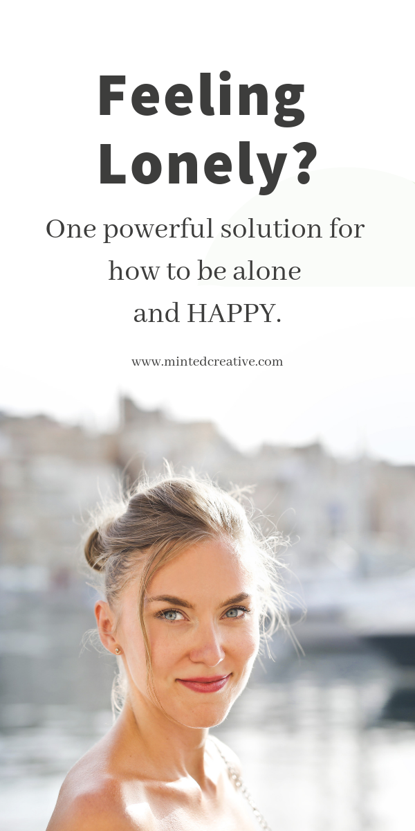 smiling brunette with text overlay - feeling lonely? one powerful solution for how to be alone and happy.